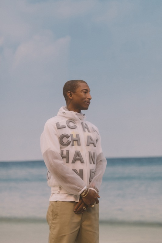 PHARRELL WILLIAMS, CHANEL Ambassador, wore a white mesh blouson, look88, from the Spring-Summer 2019 Ready-to-Wear collection. CHANEL shoes.
