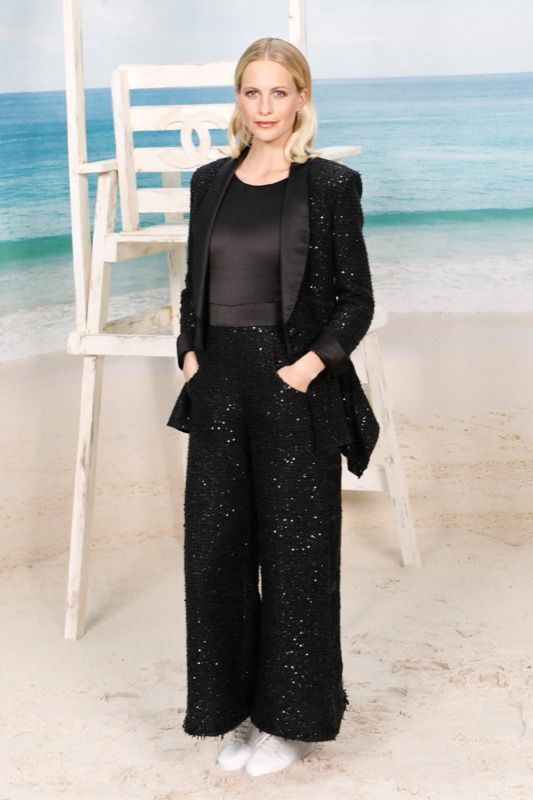 The English actress, POPPY DELEVINGNE, wore a black jumpsuit & sequins jacket, from the Fall-Winter 2018/19 Ready-to-Wear collection. CHANEL shoes & bag. CHANEL Makeup