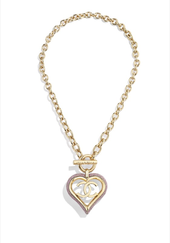 Necklace in golden metal and pink strass