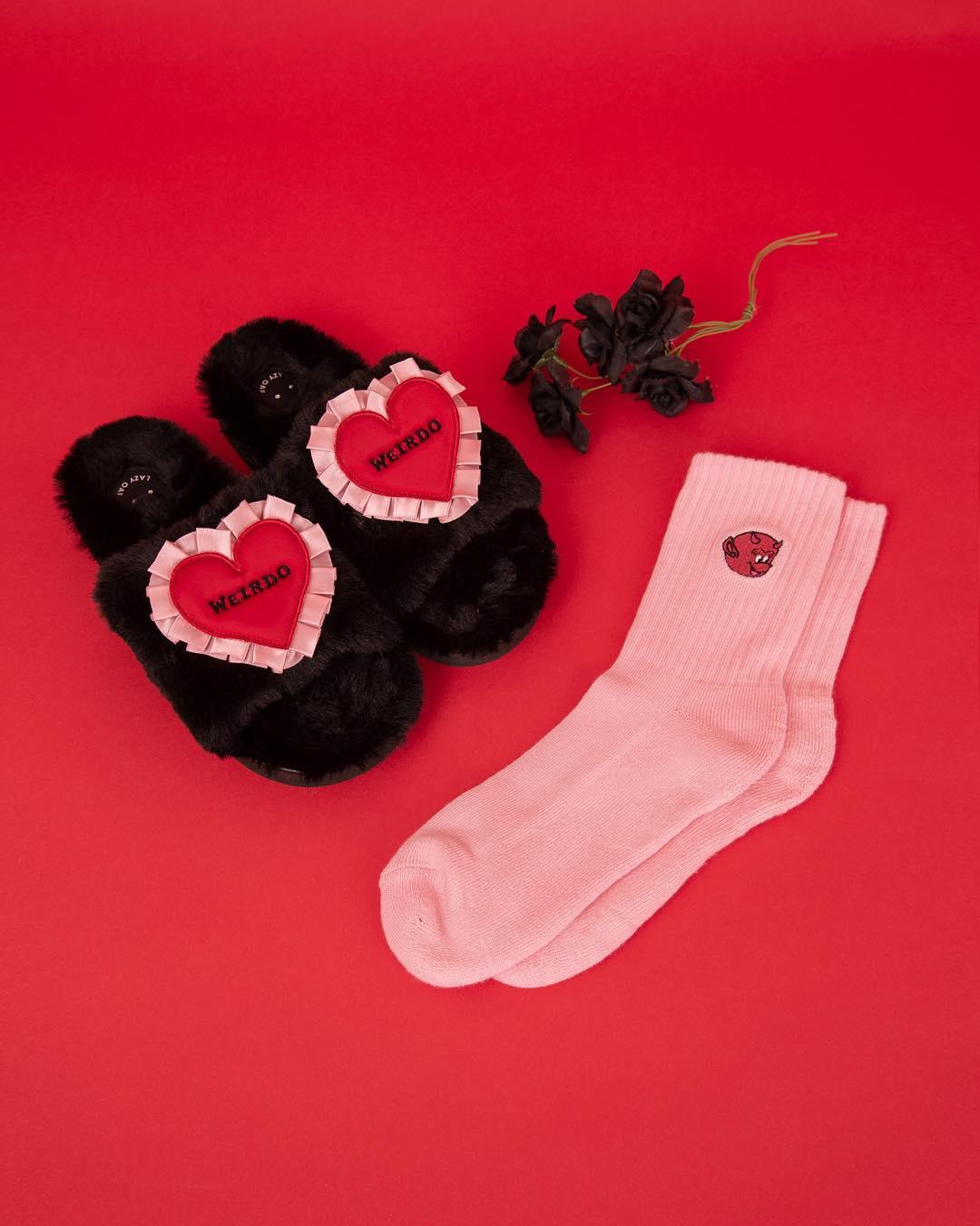 Lazy Oaf Weirdo Slippers, US$48.24 ; Lazy Oaf Little Devil Socks, US$8.58
