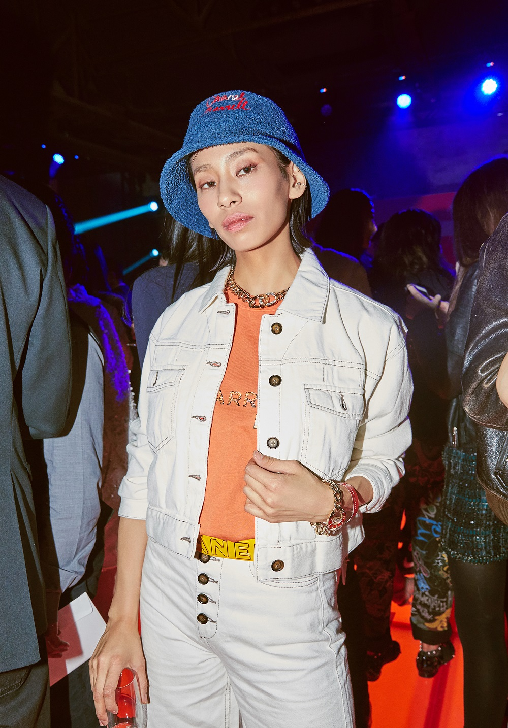 Anna Kim wore an orange embroidered t-shirt and accessories from the CHANEL-Pharrell capsule collection.