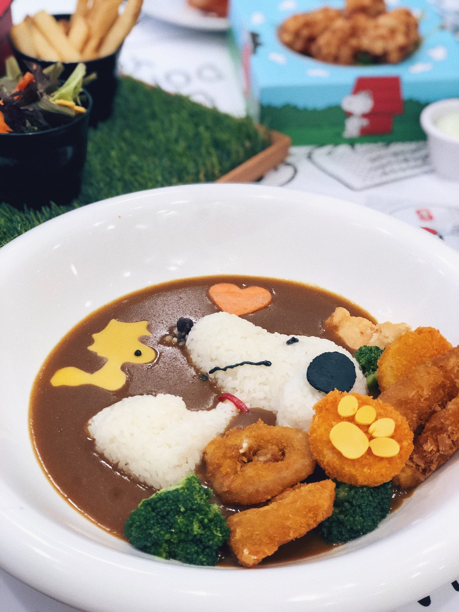 Snoopy Sizzling Seafood Tempura With Japanese Curry Rice ($24.90)