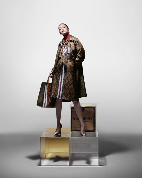 THE LADY: a nylon car coat, a silk shirt with a contrasting collar and cuffs, a silk A-line skirt, a tote bag, a silk square scarf and pumps.
